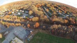 Dodgeville is an older village with mostly older houses.  Here's a shot from 250' up showing the newer, larger houses on the other side of the tracks.  Fall foliage is just starting to fade....