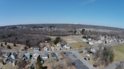 This is shot from the DodgeVille MA. soccer field from about 300' up.  You can see the St. Stephen's cemetary and the plot of rich green grass where St. Stephen's church resided until recently.