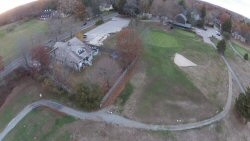 This house is actually located on the second fairway and has its share of broken windows, shutters, etc.  They also get to sell a lot of golf balls at flea markets.  This shot is from about 125' up.  It's a real bitch chipping around the trees in that yard.