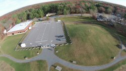 This is the Seekonk PUblic Library.  It couldn't open for years after it was built as it was built on the old dump site.  Methane gas !!!  You can see the mound on the grounds with  vent tubes.